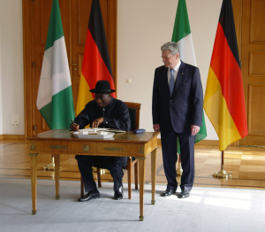 President Joachim Gauck looks on as President Goodluck Jonathan signs the Guest Book at the Castle Bellevue Photo Musah